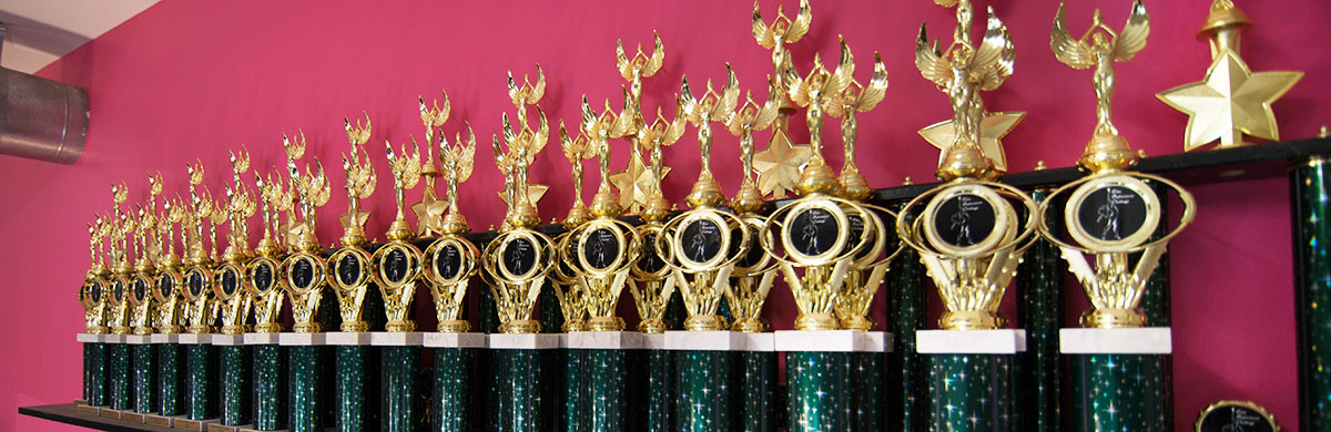 line of trophies won by FSA competetive students