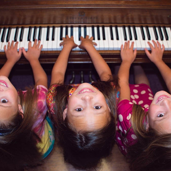 triplets practicing piano